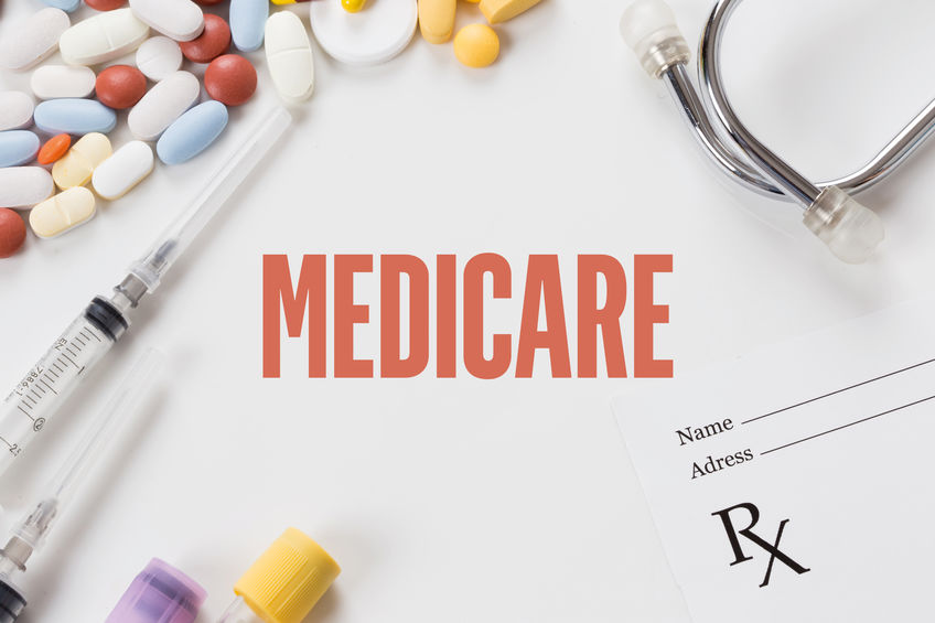 Photograph of Medicare showing some medication pills, stethoscope, syringes and prescription