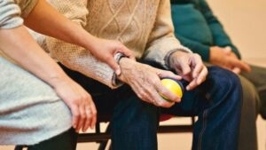 Image showing elderly person and his caregiver